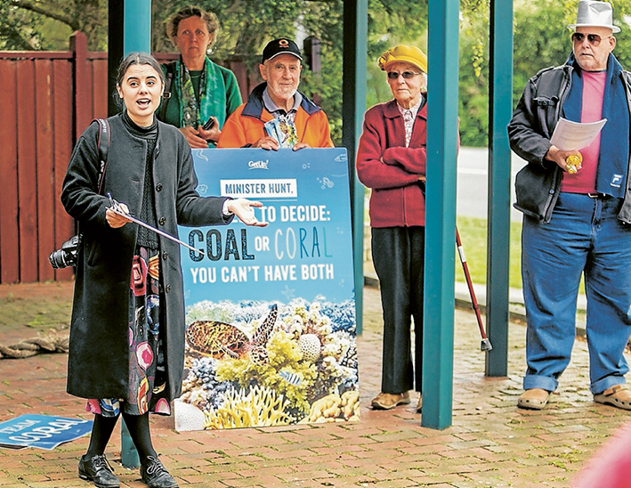 Persistent: GetUp members opposing new coal mines in Queensland have again protested outside the Hastings office of peninsula MP and environment minister Greg Hunt, the third time this month. Picture: Yanni