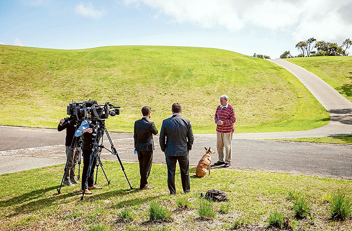 Cull anger: John Henshaw and his dog Izzy being filmed by Melbourne TV stations at the RACV resort in Cape Schanck last Friday afternoon. RACV management in Melbourne has said the cull will not occur. Picture: Yanni