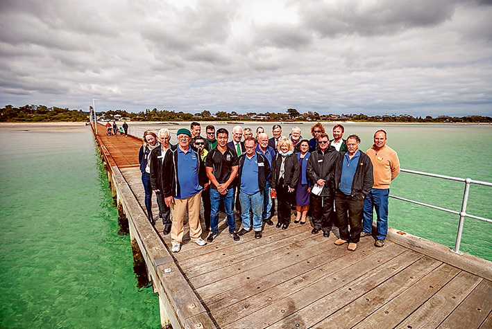 Wooden you know: Nepean MP Martin Dixon, shire mayor Cr Bev Colomb, area councillors Antonella Celi, David Gibb and Graham Pittock, shire staff, Parks Victoria staff, pier contractors and members of Pines Men's Shed were among those celebrating the official opening of Rosebud pier last Friday. Picture: Yanni