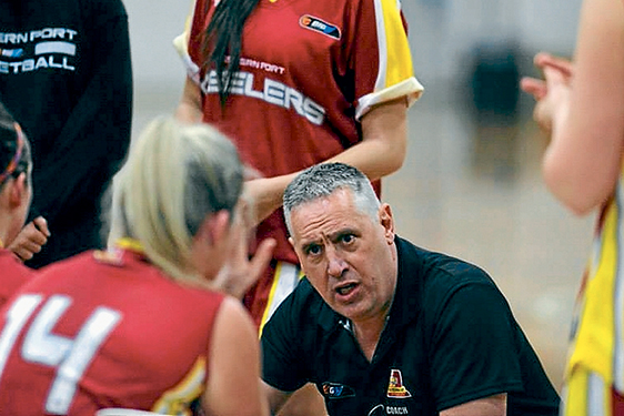 Giving advice: Western Port Lady Steelers coach Andrew Jacobson during the team's first appearance in Division 1.