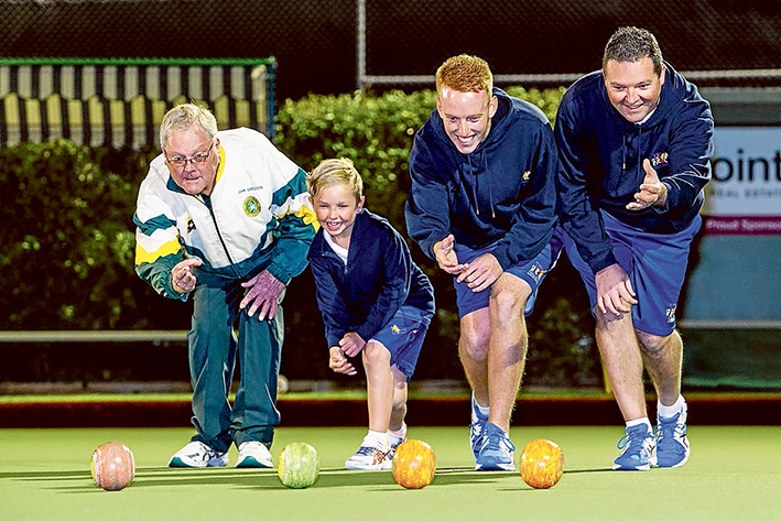 Family style: Grandfather John Gregson, seven year old Jett Simmons, Stepson Dylan Fisher and father Todd Simmons bowl at Mt Eliza Bowls Club season launch. Picture: Gary Sissons