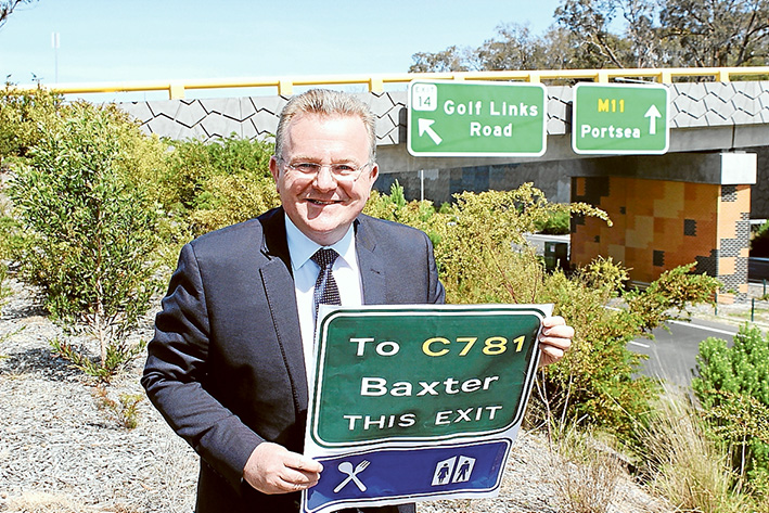 New direction: Federal Dunkley MP Bruce Billson said new signage will be installed on Peninsula Link in time for summer.
