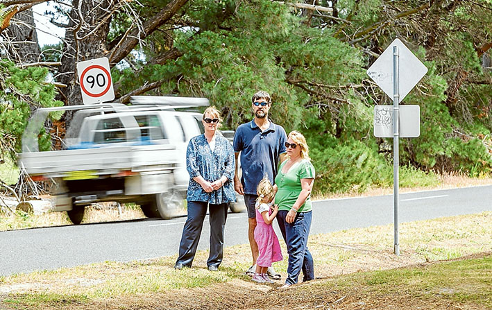 Too fast and too furious: Shelley and Robin King, Leonie Clark and daughter Gwen, want the speed limit on Davies Rd, Bittern, cut to possibly save lives. Left: the latest car to leave the road leading to the Navy's training base, HMAS Cerberus. Pictures: Yanni