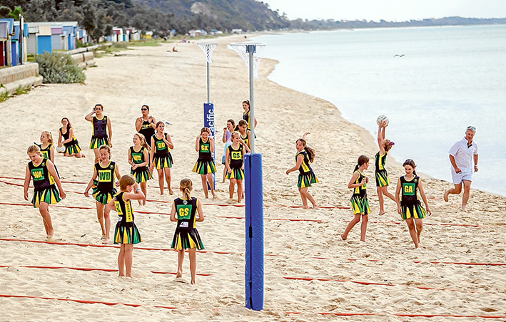 Action aplenty: Dromana Junior Netballers compete at the beach. Picture: Yanni