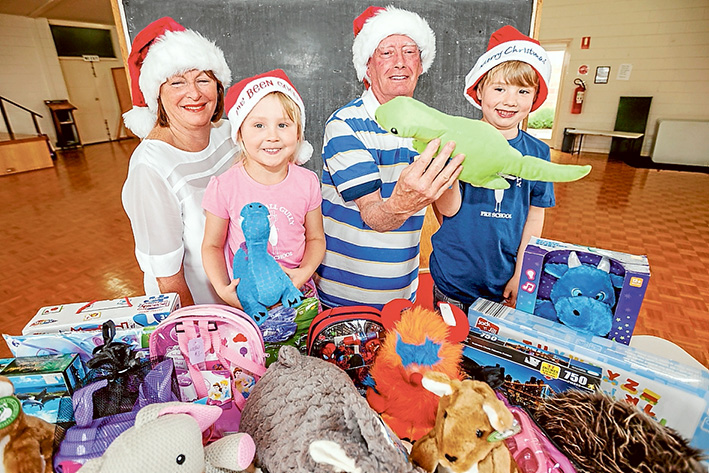 Toys aplenty: Margaret Davis, Josie Waller, Don Mc Laughlin and Jai Hunter urge the public to give generously this Christmas. Picture: Yanni
