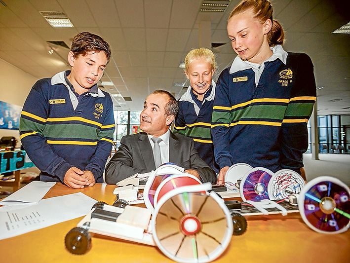 All the fun of the fair: left, Education Minister James Merlino with Somers Primary School pupils Cooper Squire, Zara Belle and  Joanna Mikkelson. Right, Brendon, Aaron and Jake from Tyabb Railway Primary School demonstrate their coloured  water droplet experiment. Below, Luke, Tara, Pia, Luke and Henry from Balnarring Primary School use entertainment to showcase science. Pictures: Yanni