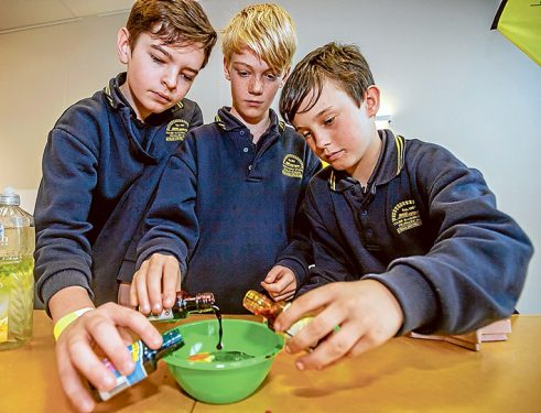 Brendon, Aaron and Jake from Tyabb Railway Primary School demonstrate their coloured water droplet experiment.