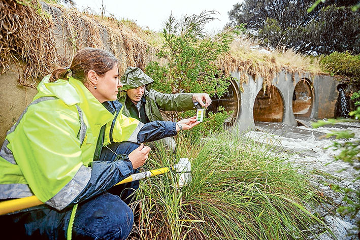 Water quality: EPA project officer Melissa Burrage and the shire's senior environmental health officer Peter O'Brien test the raging waters of Tanti Creek Mornington. Picture: Yanni