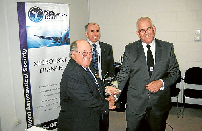 Here's to you: Peninsula Aero Club president Peter Bernardi accepts the Aero Club of the Year award from Captain David Jacobson watched by Royal Aeronautical Society chairman Murray Stimsom.