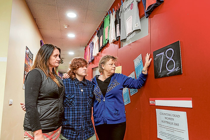 Deadly toll: Students Rachel Dodd, Olly Brayne and Errin Lindner at the Counting Women display at Chisholm TAFE's Frankston campus. Picture: Gary Sissons