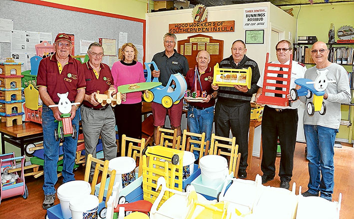 Present day supporters: Woodworkers of the Southern Peninsula president John Bayliss, left, with John Parrent, Good Shepherd Foundation's Mandy Petry, Community Bank senior manager Gary Sanford, secretary Greg Millar, Southern Peninsula Food for All's Ken Northwood, Rosebud Salvation Army Corp's Russell Butcher, Westernport Giving Program's Mike O'Grady.
