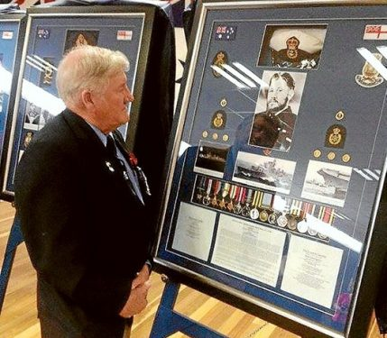 Heroism recognised: VC winner Keith Payne inspects the George Cross display.