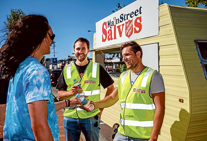 Ready to serve: Mornington Salvation Army officer Sean Mapleback along with volunteers like Sam Hearne will hand out water and snacks to late night revellers like Te Tai Atkins as they leave the pubs and clubs. Picture: Yanni