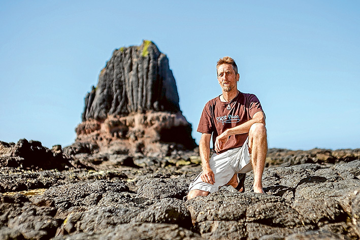 Pride of place: Photographer Matt Mackay at Pulpit Rock, Cape Schanck, one of his favourite places on the Mornington Peninsula which features in his 2016 calendar. Picture: Yanni