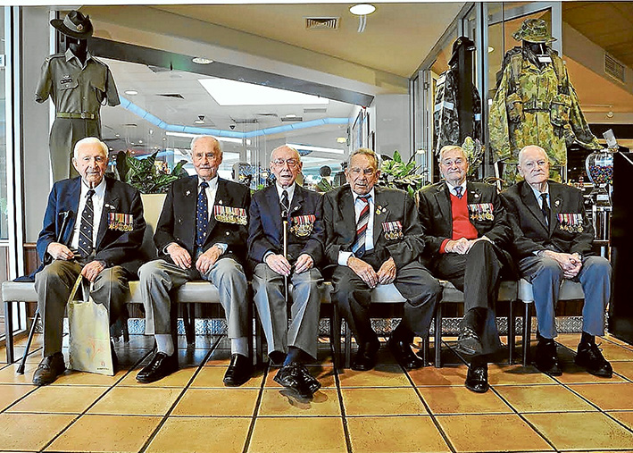 Anzac spirit: Rye RSL veterans Jack Lever (Army), Ken Gibson (Army), Stan Price (RAN), Les Butler (Army), Len Rowler (RAN) and Ray Ruby (Army) take their places for a photographic tribute.