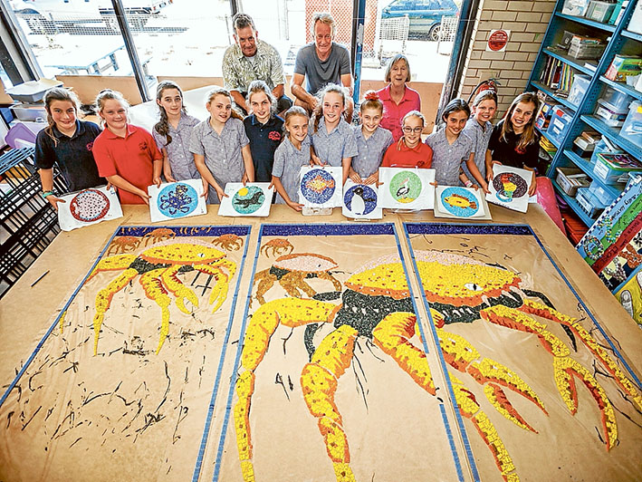 Colourful creation: Artist Simon Normand, action group president Michael Wittingslow and teacher Mechelle Cheers with the grade 5 mosaic makers. They are Tiah, Skye, Casey, Keely, Greta, Jemma, Ashley, Imogen, Caitlyn, Faizah, Ocearna and Billie. Picture: Yanni
