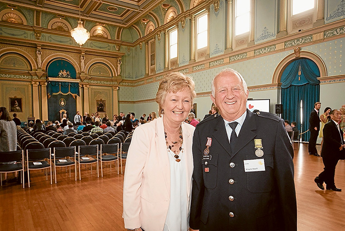 Job well done: Wayne Etcell and partner Dawn Tonge at Government House after receiving the Metropolitan Volunteer of the Year – Dame Elisabeth Murdoch Award.