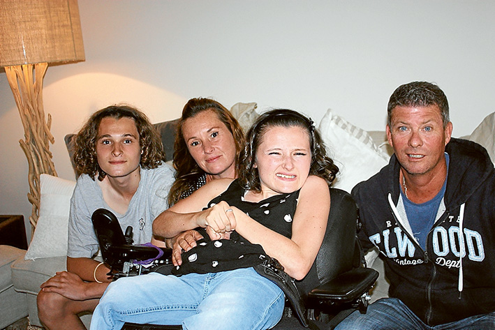Appealing: Ethan, Fiona and Maygan Garland with Glenn Browne, who is about to take 1000 steps to bolster an appeal to raise money for the family to have wheelchair-friendly vehicle.