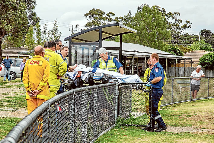 Locked out: Paramedics were forced to carry an injured Baxter woman to a waiting air ambulance because no keys were available to open gates for them to drive a vehicle onto the Fruitgrowers' Reserve, Somerville. Picture: Gary Sissons