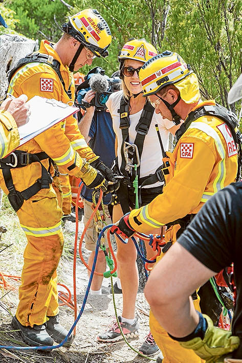 Members of Frankston SES with the dog Mailey, who started the drama by jumping down the cliff, and a friend of the rescued woman.