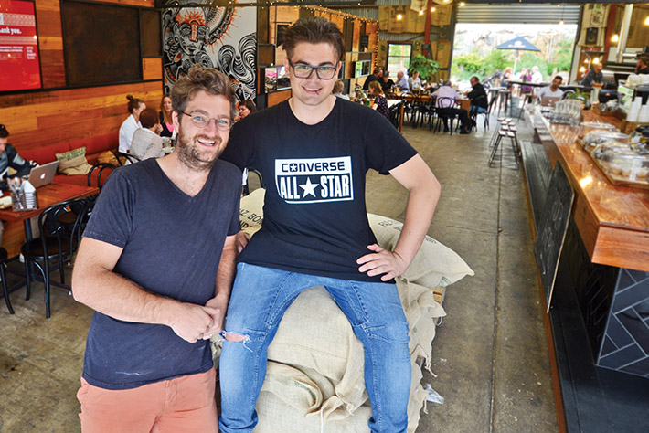 Fertile ground: The art of coffee making is now a big part of Leigh Williams' life, right, seen here with Commonfolk cafe's Sam Keck. Picture: Jarryd Bravo