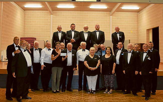Good cause: Members, visitors and guests of Balnarring Lodge after the presentation of the $5000 cheque.