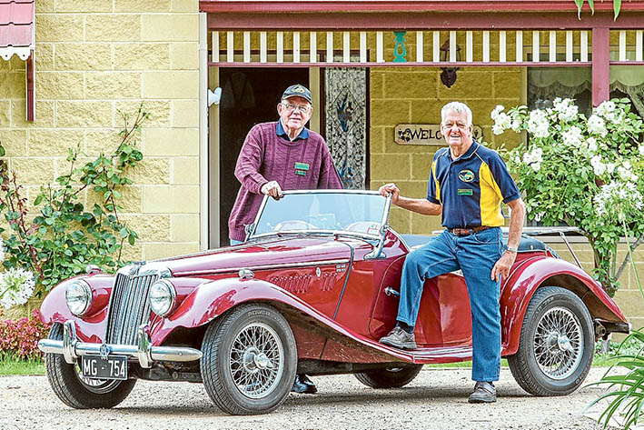 """Lure of the road: RACV Great Australian Rally organiser Len Butcher and Ben Mayne prepare Ben's 1954 MG TF roadster for last year's rally. This year Len will drive his """"Green Monster"""" – a 1951 Series 1 Vanguard."""