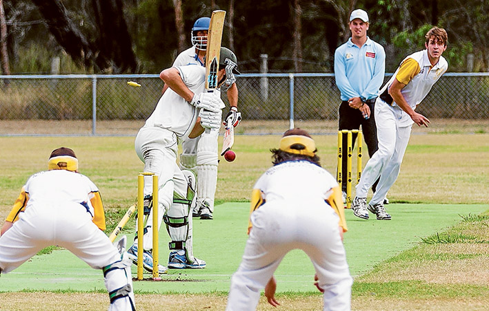Gone: A wicket leaves the dirt as Hastings batsmen fall. YCW will go on to win the match. Picture: Andrew Hurst