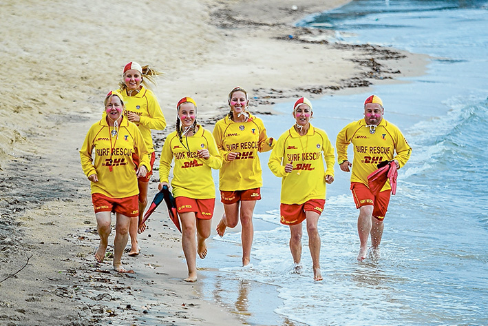 Girl power: An all-female patrol will ensure safety in the water at Gunnamatta on 14 February. They include Fran Brown, Dani Silvester, Emma Brown, Lucy Douglas and Jill Douglas, with the assistance of regional officer Toby Dobell.    Picture: Yanni
