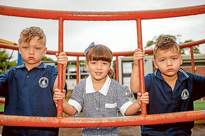 Three times the fun: Triplets Donna, Dimitri and Andreas Watson enjoyed their first day at Mornington Primary School last week. Picture: Yanni