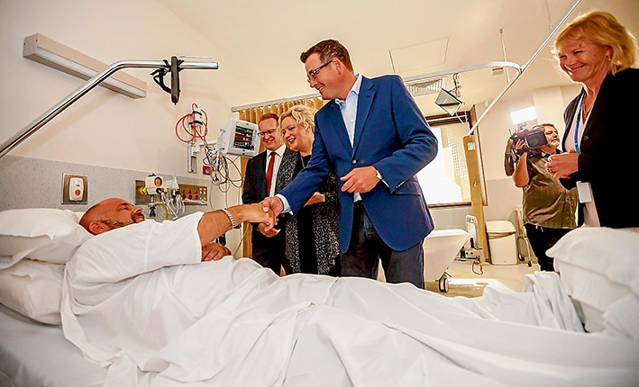 Helping hand: Premier Daniel Andrews, right, talks to cardiac patient Mark Meaney from Rosebud, with Frankston MP Paul Edbrooke and Health Minister Jill Hennessy at Frankston Hospital's new Rapid Assessment Chest Pain Unit. Picture: Yanni