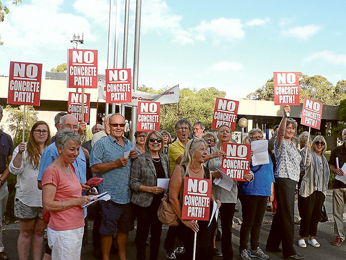 Path protest: Somers residents opposed to concrete footpaths and how they are being financed show their feelings before Mornington Peninsula Shire's 8 February meeting. Councillors decided to proceed with a special charge scheme.