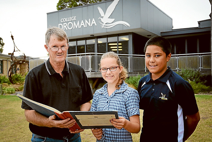 Then and now: Dromana College Year 7 students Kate Ellis and Mark Meafau, both 12, with the school's first pupil, Trevor Birch. Picture: Derry Caulfield