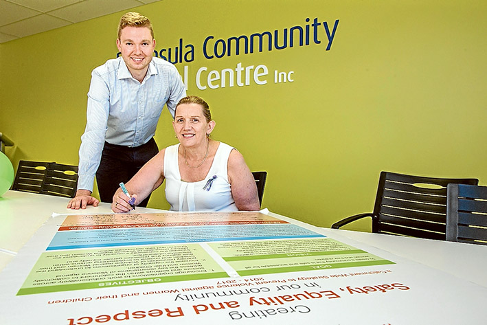 Safety first: Primary Care Partnership's John Baker and Peninsula Community Legal Centre CEO Jackie Galloway sign The Peninsula Model pledge to prevent violence against women and children. Picture: Gary Sissons