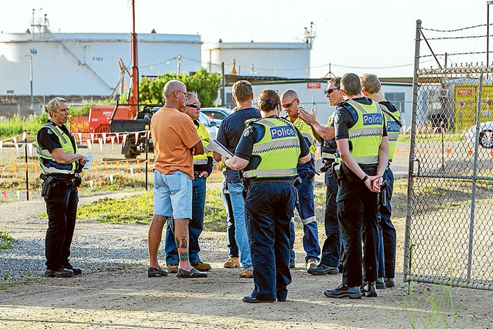 Line in the sand: Police and picket-line organisers outside the gates of United Petroleum Hastings, last week. Picture: Gary Sissons