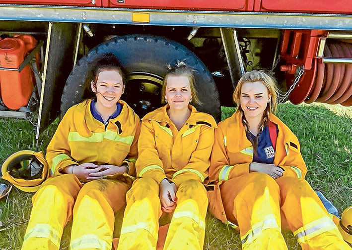 Break time: CFA firefighters Ally Smith (Bittern) Alicia Jackson (Crib Point) and Bree Carrigg (Somerville) take a break from firefighting duties. Picture: Adam Carrigg