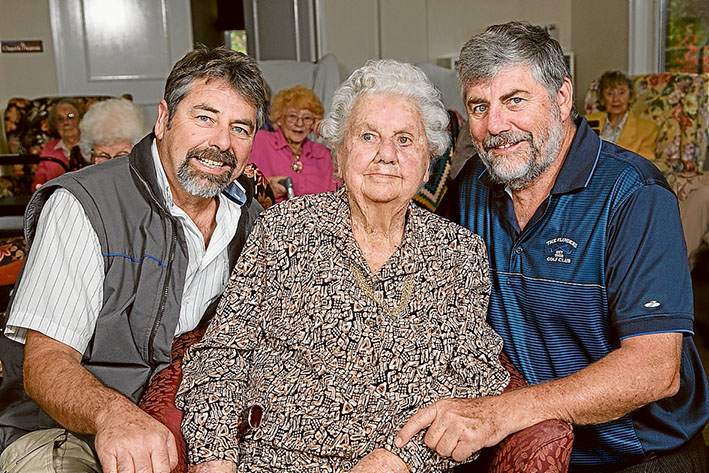 Happy birthday mum: Brothers Phillip and Ian with mum Dorothy Johnson at her centenary celebration at Shoreham House. Picture: Gary Sissons