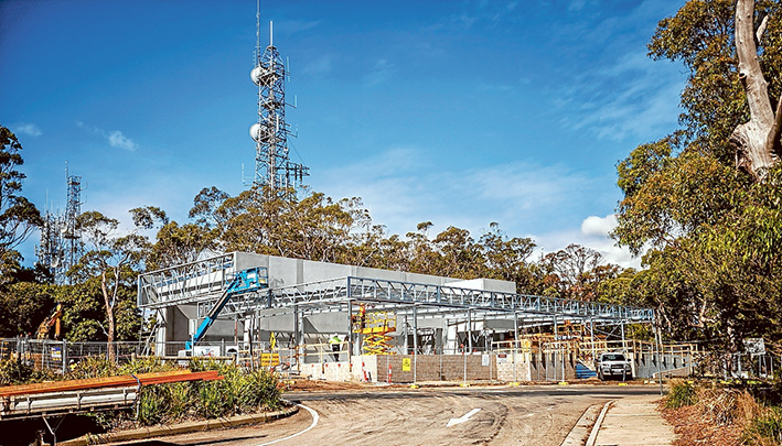 Shaping up: Despite some ongoing planning hurdles, Skylift infrastructure continues to be built at Arthurs Seat, including the top station, above, and, top, clearing for pylons which will hold cables along which the gondolas will run. Pictures: Yanni