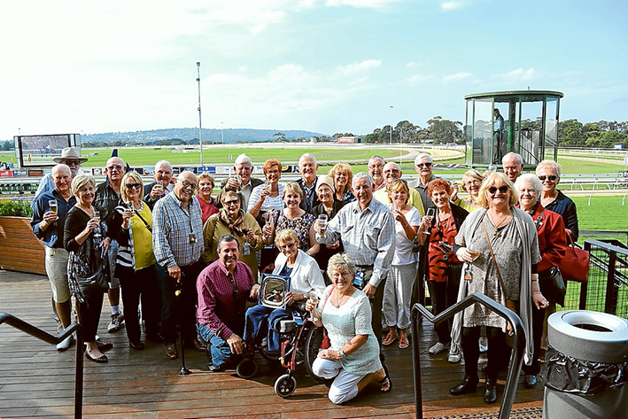 To their Belle: Beleura Village residents, above, toast the much-loved filly's success at Mornington, Monday.