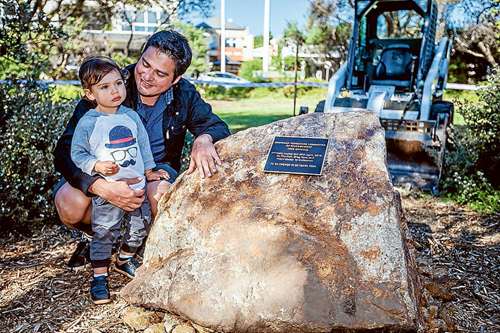 Rock of ages: Rafael Acosta and son Henry ponder the next 50 years – when the Dromana time capsule will be opened. Pictures: Yanni