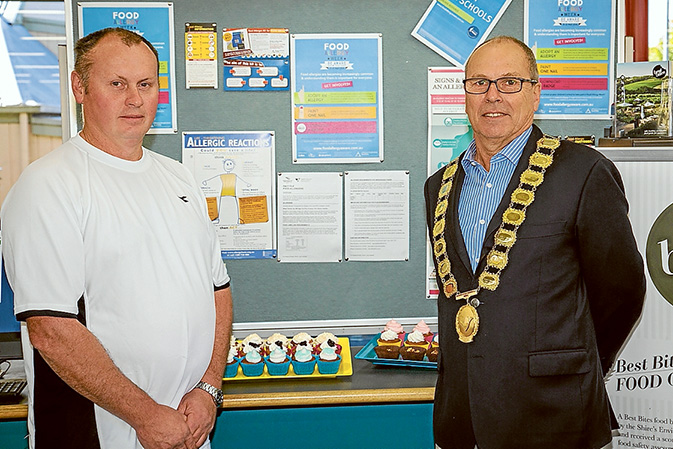 Allergy display: Paul Phillips, of T-Rose artisan bakery, Tyabb, with the mayor Cr Graham Pittock at the Food Allergy Awareness display, Hastings library. Food Allergy Week runs 15-21 May.