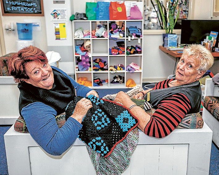 Stitch in time: Volunteers Bev Storey and Cynthia Emery with knits for those in need at Southern Peninsula Community Support and Information Centre. Picture: Yanni