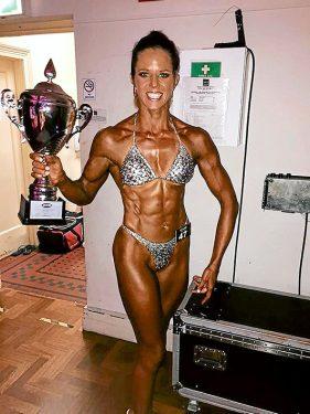 Winner's spoils: Figure competitor Kim Parrott enjoys the rewards of her success.
