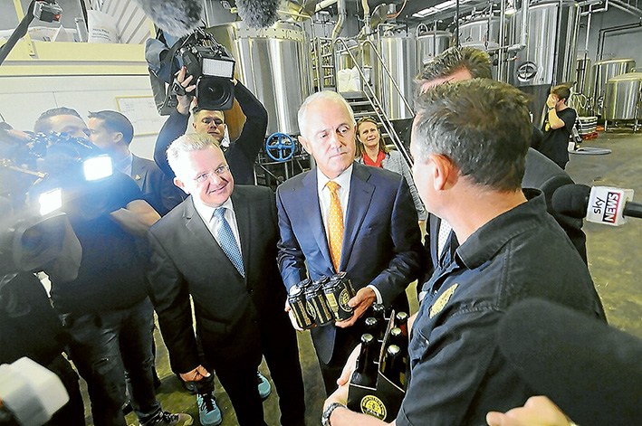 Packing them in: Liberal Dunkley MP Bruce Billson and Prime Minister Malcolm Turnbull followed by TV news crews visit the Mornington Peninsula Brewery. Picture: Jarryd Bravo