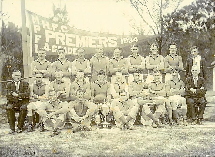 Hastings Football Club premiership team of 1934: (Back row) J. A. McMillan, R. L. Clarke, J. E. Unthank, E. W. Fisher, A. J. Heggen, H. W. Hodgins, N. K. Jones, C. Tolson, G. Parscisson (Trainer). (Middle row) H. Hoddock (Secretary), F. Denham, H. Jack, G. Perrott (Vice-Captain), T. Mirabella (Captain), C. P. Perrott, G. Mirabella, R. Mentiplay, P. Wilson, T. H. Barclay (President). (Front Row) C. E. Horsburgh, B. Wilson, S. Mirabella, L. Mentiplay. (Absentees) R. L Storey, H. Porter.