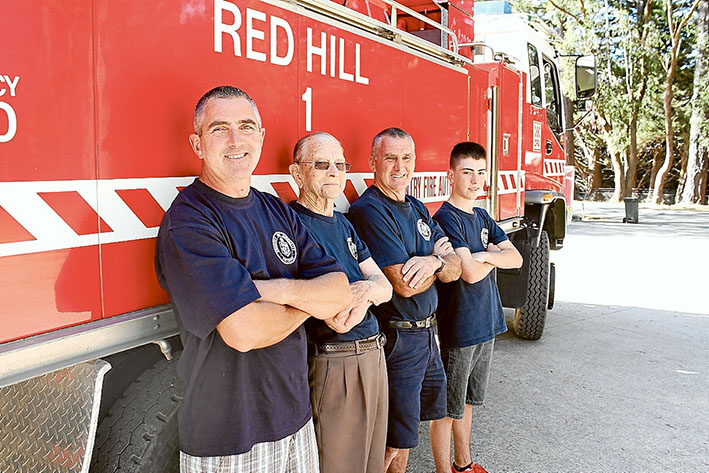 Fire ready family: Red Hill volunteer firefighters Anthony, Roy, Darrel and Lachlan Setter beside the big red truck. Picture: Raelene Gard, of District 8.