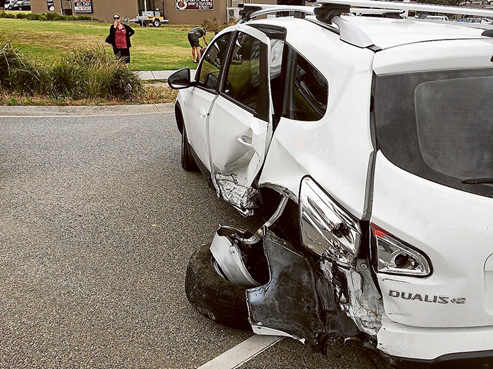 Off the road: Michelle Sheridan's now unrecognisable seven-seater is probably the only thing that saved her when her car was struck at the lights in Cranbourne-Frankston Rd in December.