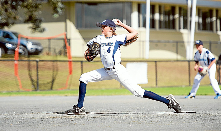 Batter beware: Genevieve Beacom doing what she loves: pitching – hard – against the boys.
