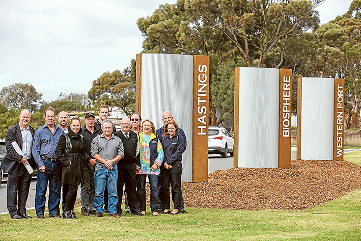 Signed up: Some of those involved with producing the new sign on Marine Pde leading into Hastings, from left, David Garnock, Ray Francis, James McNeur, Angie Baker, Dirk Rynaard, Craig Rynaard, Bryan Stone, Chris Watt, Mark Birtles, Del Skinner, Ron Bange and Amanda Burston. Picture: Supplied