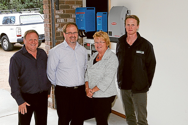 Powered up: The team behind the manufacture and marketing of a battery designed to store electricity on which houses can be run overnight or when solar power is unavailable, from left, Max Coulthard, David Treanor, Margaret Harrison and David Jung. Below, six of the lithium battery packs can power a house for about three days.
